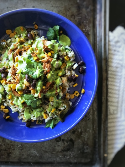 chipotle burrito bowl with roasted black bean and corn salsa served in blue bowl